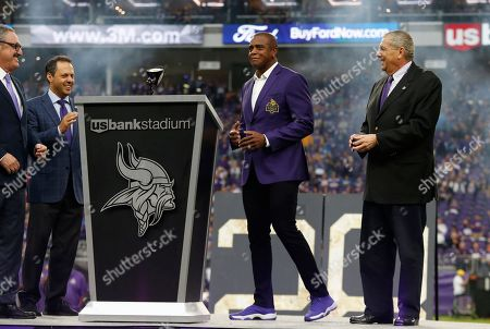 Stock Picture of Former Minnesota Vikings wide receiver Ahmad Rashad, center, is inducted into the Vikings Ring of Honor during halftime of an NFL football game between the Vikings and the Detroit Lions, in Minneapolis