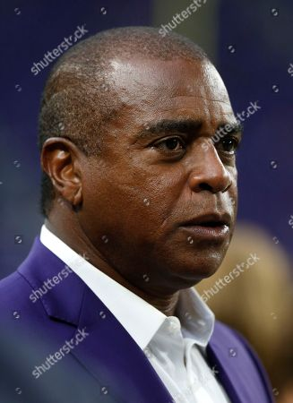 Former Minnesota Vikings wide receiver Ahmad Rashad stands on the field before an NFL football game between the Vikings and the Detroit Lions, in Minneapolis