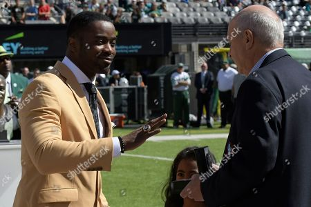 Former New York Jet Curtis Martin, left, participates in a ceremony before an NFL football game between the New York Jets and the Jacksonville Jaguars, in East Rutherford, N.J