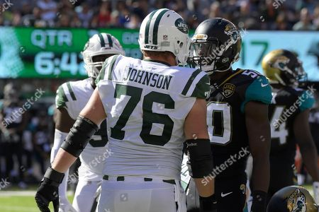 Wesley Johnson, Telvin Smith. New York Jets' Wesley Johnson (76), left, stares down Jacksonville Jaguars' Telvin Smith during the second half of an NFL football game, in East Rutherford, N.J