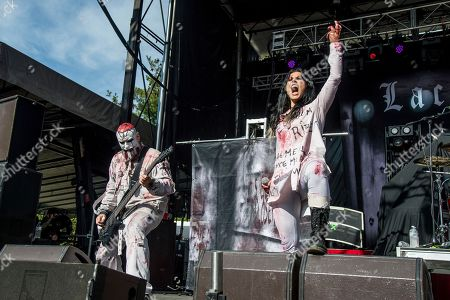 Marco Coti Zelati, Cristina Scabbia. Marco Coti Zelati, left, and Cristina Scabbia of Lacuna Coil perform at the Louder Than Life Music Festival at Champions Park, in Louisville, Ky