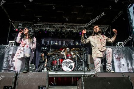 Christian Thompson, Andrea Ferro. Christian Thompson, left, and Andrea Ferro of Lacuna Coil perform at the Louder Than Life Music Festival at Champions Park, in Louisville, Ky