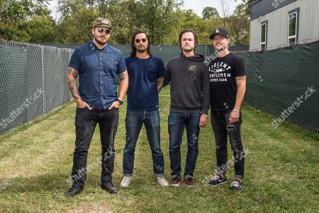 Stock Image of Dustin Kensrue, Teppei Teranishi, Eddie Breckenridge, Riley Breckenridge. Dustin Kensrue, from left, Teppei Teranishi, Eddie Breckenridge and Riley Breckenridge of Thrice pose at the Louder Than Life Music Festival at Champions Park, in Louisville, Ky