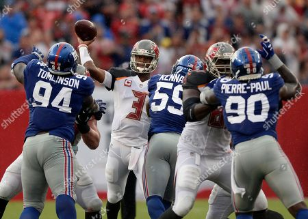 Jameis Winston, Dalvin Tomlinson, Devon Kennard, Jason Pierre-Paul. Tampa Bay Buccaneers quarterback Jameis Winston (3) throws a pass as he is pressured by New York Giants defensive tackle Dalvin Tomlinson (94), outside linebacker Devon Kennard (59) and defensive end Jason Pierre-Paul (90) during the first quarter of an NFL football game, in Tampa, Fla