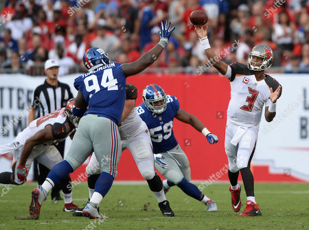 Tampa Bay Buccaneers quarterback Jameis Winston (3) throws a pass over New York Giants defensive tackle Dalvin Tomlinson (94) during the second quarter of an NFL football game, in Tampa, Fla