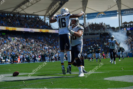Los Angeles Chargers wide receiver Tyrell Williams, above, celebrates with teammate offensive guard Matt Slauson after scoring a touchdown during the first half of an NFL football game against the Philadelphia Eagles, in Carson, Calif