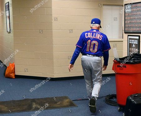 New York Mets manager Terry Collins walks from his office after resigning as manager following a game against the Philadelphia Phillies, in Philadelphia. New York Mets manager Terry Collins resigned Sunday and will take a position in the team's front office. Collins announced the move after the Mets lost to Philadelphia 11-0 to finish the season