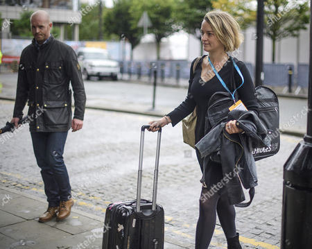 BBC political editor Laura Kuenssberg seen arriving on the opening day of the Conservative Party Conference with her body guard (pictured left). There have been conflicts within the conservative party and government over the UK's approach to Brexit, which is expected to feature heavily at this years event.