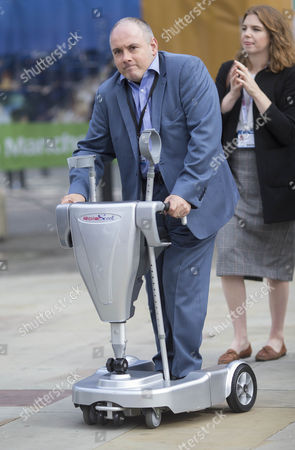 Robert Halfon MP using his mobility scooter.