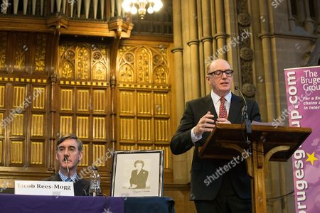Jacob Rees-Mogg with a framed portrait of Baroness Margaret Thatcher, listening to Gerard Lyons speak, at a fringe, right-wing Bruges Group event at Manchester Town Hall