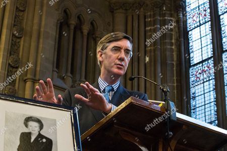 Jacob Rees-Mogg and a framed portrait of Baroness Margaret Thatcher, speaking at a fringe, right-wing Bruges Group event at Manchester Town Hall