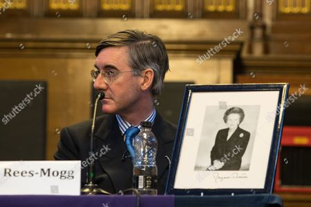 Stock Photo of Jacob Rees-Mogg and a framed portrait of Baroness Margaret Thatcher, at a fringe, right-wing Bruges Group event at Manchester Town Hall during the second day of the Conservative Party Conference