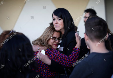 Stock Image of Maritza Rodriguez, right, embraces Emily Zamora after a special service at Guardian Angel Cathedral for the mass shooting on the Las Vegas Strip, in Las Vegas