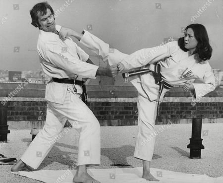 Karate Expert Brian Hammond With Beauty Queen Teresa Chu (miss Hong Kong) Showing Off Her Karate Skills. She Is In The Uk For The Miss World Contest. Box 748 912041724 A.jpg.