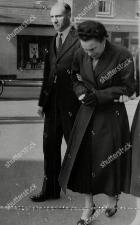 Violet Wright (known As Vicky Wright) Mother Of Reggie And Colin Wright Twins Who Died In Benfleet Houseboat Fire - Suspected Arson Case. Mrs Wright Is Supported At The Funeral Of Her Sons. Box 748 612041741 A.jpg.