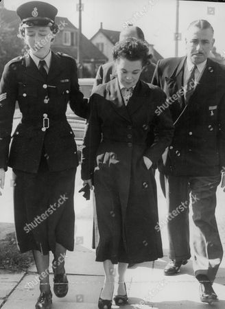Stock Photo of Violet Wright (known As Vicky Wright) Mother Of Reggie And Colin Wright Twins Who Died In Benfleet Houseboat Fire A Suspected Arson Case. Mrs Wright Arriving At Benfleet Police Station Accompanied By Sgt. Mary Barton. Box 748 612041754 A.jpg.