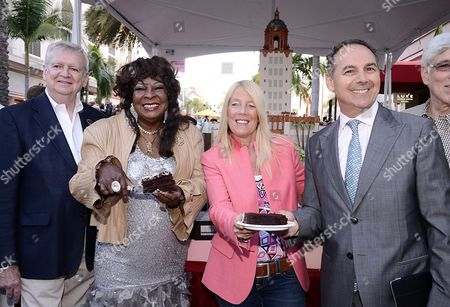 IMAGE DISTRIBUTED FOR THE RODEO DRIVE COMMITTEE - Rodeo Drive Committee President Jim Jahant and from left, singer Martha Reeves, Beverly Hills Mayor Lili Bosse and Luxe Hotels Owner Efrem Harkham pose together in front of a massive 15 foot by 20 foot cake presented by the Luxe Hotel Rodeo Drive and Guittard Chocolate at the BH100 Centennial Block Party on Rodeo Drive, in Beverly Hills, Calif. The block party also featured carnival rides, games, and fireworks in celebration of the city's 100th birthday
