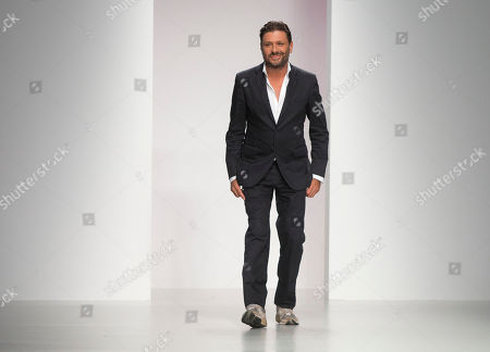 Designer Filippo Scuffi of Daks takes the applause after his show during London Fashion Week Spring/Summer 2014, at Somerset House in central London