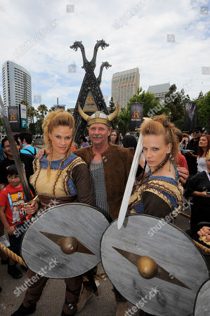 Viking Sheild Maidens pose with a fan at All Hail Vikings: An Interactive Experience outside the 2013 Comic-Con International Convention on in San Diego. Throughout the weekend, fans competed in longboat races in a custom 50-foot waterway, met with cast members and received a limited edition comic book written by series creator Michael Hirst
