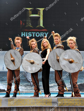 """IMAGE DISTRIBUTED FOR CIVIC ENTERTAINMENT GROUP - Katheryn Winnick of HISTORY's """"Vikings"""" poses with Shield Maidens at All Hail Vikings: An Interactive Experience outside the 2013 Comic-Con International Convention on in San Diego. Throughout the weekend, fans competed in longboat races in a custom 50-foot waterway, met with cast members and received a limited edition comic book written by series creator Michael Hirst"""