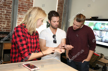 London Elise Moore, from left, Nathan Kress and Brett Davern seen at Microsoft Band Event at the Microsoft Lounge, in Venice, Calif