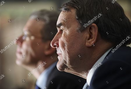 CEO Tom Albanese and outgoing Rio Tinto Chairman Paul Skinner, listen during a news conference following the Rio Tinto AGM