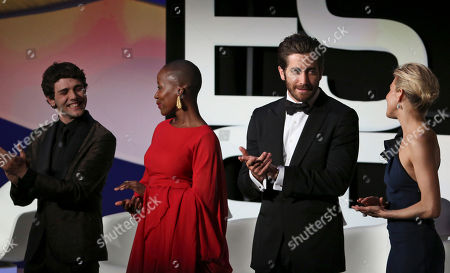From left, jury members Xavier Dolan, Rokia Traore, Jake Gyllenhaal and Sienna Miller stand on stage during the opening ceremony at the 68th international film festival, Cannes, southern France