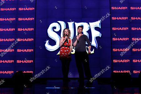 From the left. Director Kristin Hanggi and choreographer RJ Durell speak during a rehearsal performance of Surf the Musical. Sharp LED monitorsSharp LED displays provide the scenic backdrop for Surf the Musical featuring 136 Sharp LED monitors as seen on in Las Vegas