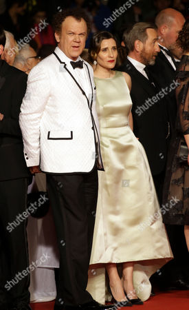 John C. Reilly and Angeliki Papoulia pose for photographers upon arrival for the screening of the film The Lobster at the 68th international film festival, Cannes, southern France