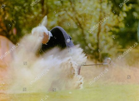 Golfer Neil Cole Blasts Clear From A Bunker At The 11th Hole At Royal Lytham St Annes During The British Seniors Open. Box 754 1002051749 A.jpg.