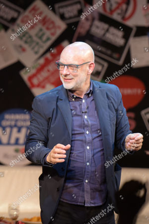 Musician, Brian Eno dancing at Saturday Night Live Manchester chat show event as part of the Take Back Manchester festival