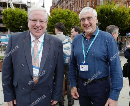 Conservative MP Sir Patrick McLoughlin MP and Sir Michael Hintze at the second day of the Conservative Party Conference