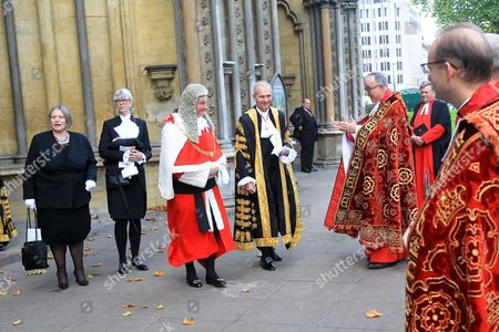 Stock Picture of The Right Honourable Sir Ian Burnett, Lord Chief Justice of England and Wales, (Red and White) The Right Honourable David Lidington CBE MP, Lord Chancellor and Secretary of State for Justice (Gold and Black) meet The The Very Reverend John Hall  following the service.