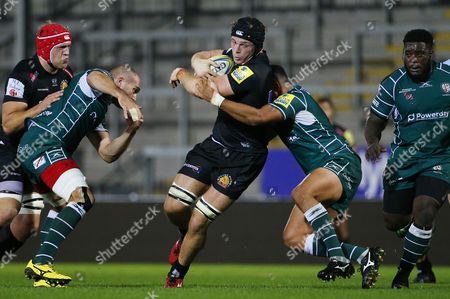 Ed Holmes of Exeter Braves is tackled by Isaac Curtis-Harris of London Irish during the Aviva Premiership A-League match between Exeter Braves and London Irish at Sandy Park on October 2nd 2017 , Exeter, Devon (