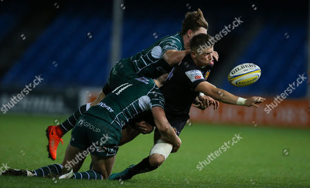 Harvey Skinner of Exeter Braves is tackled by Ben Ransom of London Irish and Ollie Hassell-Collins of London Irish during the Aviva Premiership A-League match between Exeter Braves and London Irish at Sandy Park on October 2nd 2017 , Exeter, Devon (