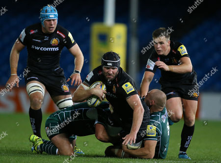 Wilhelm van der Sluys of Exeter Braves is tackled by Lasha Lomidze of London Irish and Isaac Curtis-Harris of London Irish during the Aviva Premiership A-League match between Exeter Braves and London Irish at Sandy Park on October 2nd 2017 , Exeter, Devon (