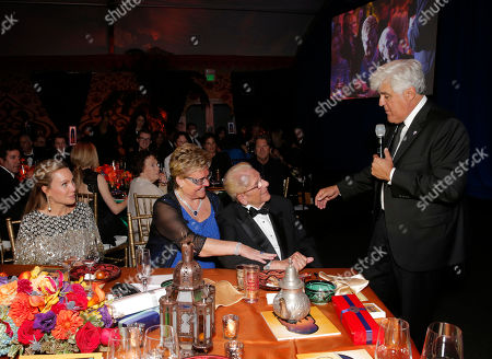 Stock Photo of From left, Cassandra Mann, Claudia Mann, Alfred Mann and Jay Leno attend the 10th annual Alfred Mann Foundation Gala, in Beverly Hills, Calif