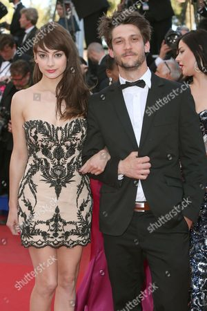 Actors Sophie Desmarais, left, and Jean-Sebastien Courchesne arrive for the screening of Behind the Candelabra at the 66th international film festival, in Cannes, southern France