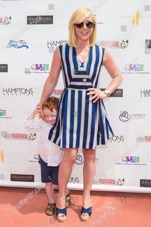 Jane Krakowski (R) and Bennett Robert Godley attend The Children's Museum of the East End's 6th Annual Family Fair in Bridgehampton, in New York