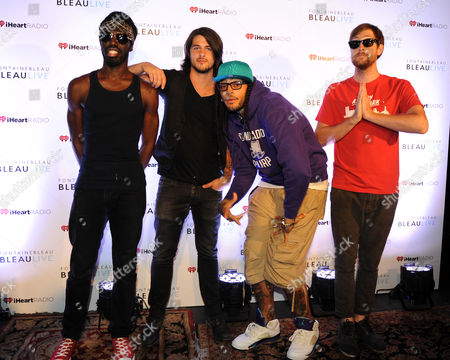 JUNE 30: (L-R) Disashi Lumumba-Kasongo,Eric Roberts,Travie McCoy and Matt McGinley arrive for the IHeartRadio concert at Fontainebleau Miami Beach on in Miami Beach, Florida