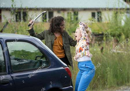 Stock Photo of Ep 9263 Monday 2nd October 2017 - 1st Ep Pretending she is going to the police Mel, as played by Sonia Ibrahim, gets Bethany Platt, as played by Lucy Fallon, to accompany her to the station but instead stops the car by some railway tracks and grabs her by the hair dragging her towards the tracks.