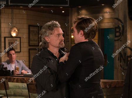 Stock Picture of Ep 9274 Friday 13th October 2017 - 2nd Ep In the Bistro, Cindy, as played by Ester Hall, comforts Daniel Osbourne, as played by Rob Mallard, over his thwarted scoop but is alarmed when her husband Ross, as played by Anthony Brophy, walks in on the intimate scene. Ross grabs Daniel as Phelan watches on, having tipped off Ross. Can Daniel avert a fight?