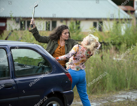 Ep 9263 Monday 2nd October 2017 - 1st Ep Pretending she is going to the police Mel, as played by Sonia Ibrahim, gets Bethany Platt, as played by Lucy Fallon, to accompany her to the station but instead stops the car by some railway tracks and grabs her by the hair dragging her towards the tracks.