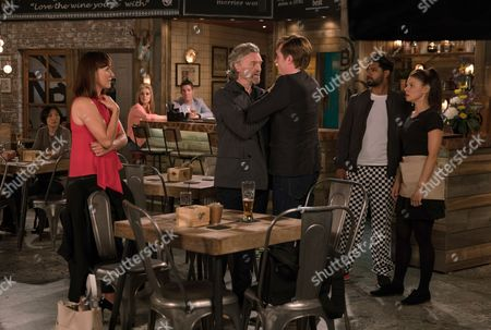 Stock Image of Ep 9274 Friday 13th October 2017 - 2nd Ep In the Bistro, Cindy, as played by Ester Hall, comforts Daniel Osbourne, as played by Rob Mallard, over his thwarted scoop but is alarmed when her husband Ross, as played by Anthony Brophy, walks in on the intimate scene. Ross grabs Daniel as Phelan watches on, having tipped off Ross. Can Daniel avert a fight?