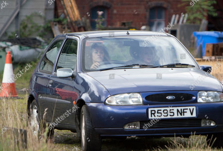 Stock Image of Ep 9263 Monday 2nd October 2017 - 1st Ep Pretending she is going to the police Mel, as played by Sonia Ibrahim, gets Bethany Platt, as played by Lucy Fallon, to accompany her to the station but instead stops the car by some railway tracks and grabs her by the hair dragging her towards the tracks.