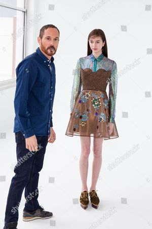 Designer Josep Font, left, stands with a model at the Del Pozo NYFW Fall/Winter 2016 fashion show at Pier 59 Studios, in New York