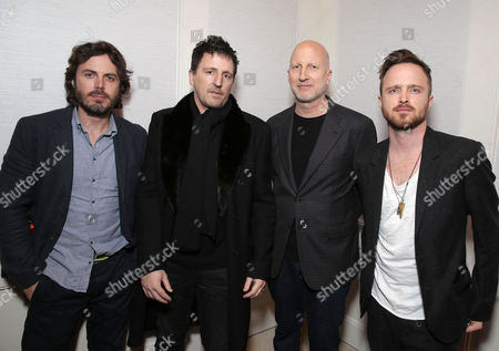 Stock Picture of Exclusive - Casey Affleck, Composer Atticus Ross, Director John Hillcoat and Aaron Paul seen at a Private Screening of Open Road's 'Triple 9' hosted by John Hellcoat, Casey Affleck, Aaron Paul and Atticus Ross at the London Hotel West Hollywood, in West Hollywood, CA