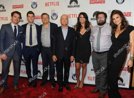 Producer Lorne Michaels, center, director Rhys Thomas, left, and Netflix Chief Content Officer Ted Sarandos, center left, are joined by Saturday Night Live cast members Colin Jost, Cecily Strong, Bobby Moynihan, left to right, and actress Gina Gershon, right, at the premiere of the movie Staten Island Summer at Sunshine Cinema, in New York. The new comedy debuts on Netflix on July 30, 2015 and is available for Digital download