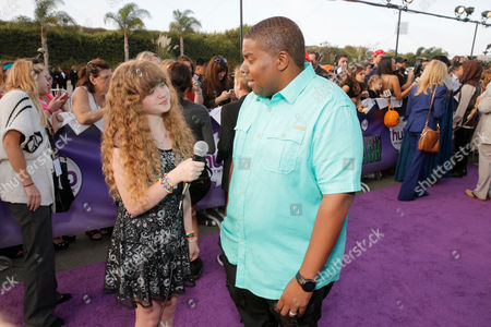 "Piper Reese, left, and Kenan Thompson arrive at ""Hub Network's First Annual Halloween Bash"", at the Barker Hanger in Santa Monica, Calif. The star-studded special will be broadcasted on the Hub Network on Saturday Oct. 26, 2013"