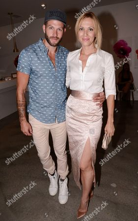 Stock Picture of Stylist Johnny Wujek, left, and stylist Tara Swennen attend the Vestiaire Collective VIP Cocktail Party hosted by Wujek at Eric Buterbaugh Flower Design on in Los Angeles